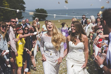 Partner Lauren Day, left, with wife Rebecca on their wedding day