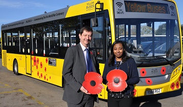 David Squire, managing director of Yellow Buses with Aleesha Edie the workshop supervisor, with the Poppy Bus