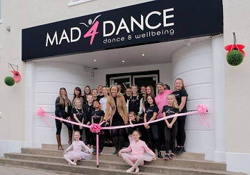 Julie Laming Cutting the Ribbon to Open the Mad4Dance home