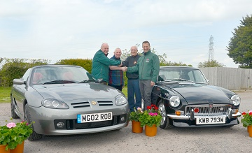 (from left) The  MG TF160 and 1980 MGBT with Stewart's Paul Hilliam, Robin Plumley, Mike and Terry Head.