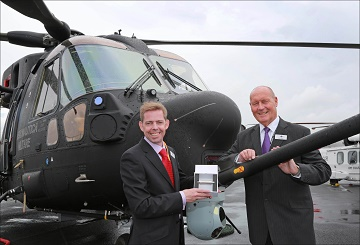 Andrew Barnett and Keith Smith of Barnbrook Systems on the Leonardo stand next to the Italian Air Force helicopter which contains their fuel switch product at Farnborough Air Show 2016.