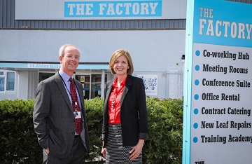 Martin Lucas , BCHA Director of Finance & Corporate Resources, with Sara Uzzell, Chair of Dorset LEP Growing Places Fund Steering Group, at The Factory, which was purchased and transformed into a business centre by BCHA following a loan from Dorset LEP