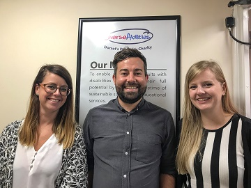 Freya Storey (left) and Cat Abbott (right) join Luke Hawker to expand the communications team at Dorset's disability charity, Diverse Abilities.