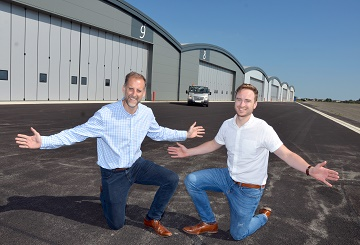 from left ) Tony Boyle with  fellow Architect Alex Watson at the new business. hangars.