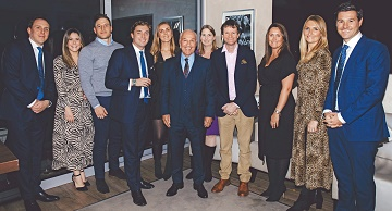 Cherries Chairman Jeff Mostyn, centre, with AFC Bournemouth Directors' Dinner guest speaker Dr Kevin Dutton, fourth right, with staff from Global Reach who sponsored the event