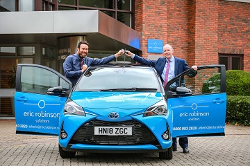 Snows Toyota Hedge End sales manager Steve Barrett, left, presents Eric Robinson Solicitors' managing partner Craig Petrie with a Toyota Yaris Hybrid