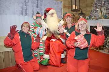 Santa and some of the latest Elves recruited and June Borley (1st Left) and Alex Coombes  (2nd Left).