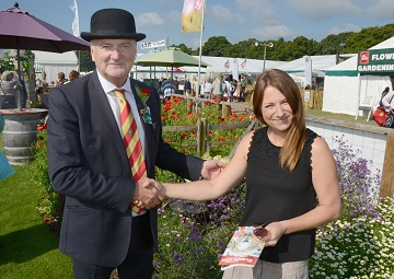 Martin Stewart congratulates Rebecca Moy at the award winning wild meadow stand.